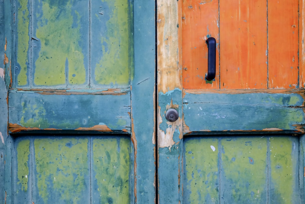 closeup view of blue and green wooden door