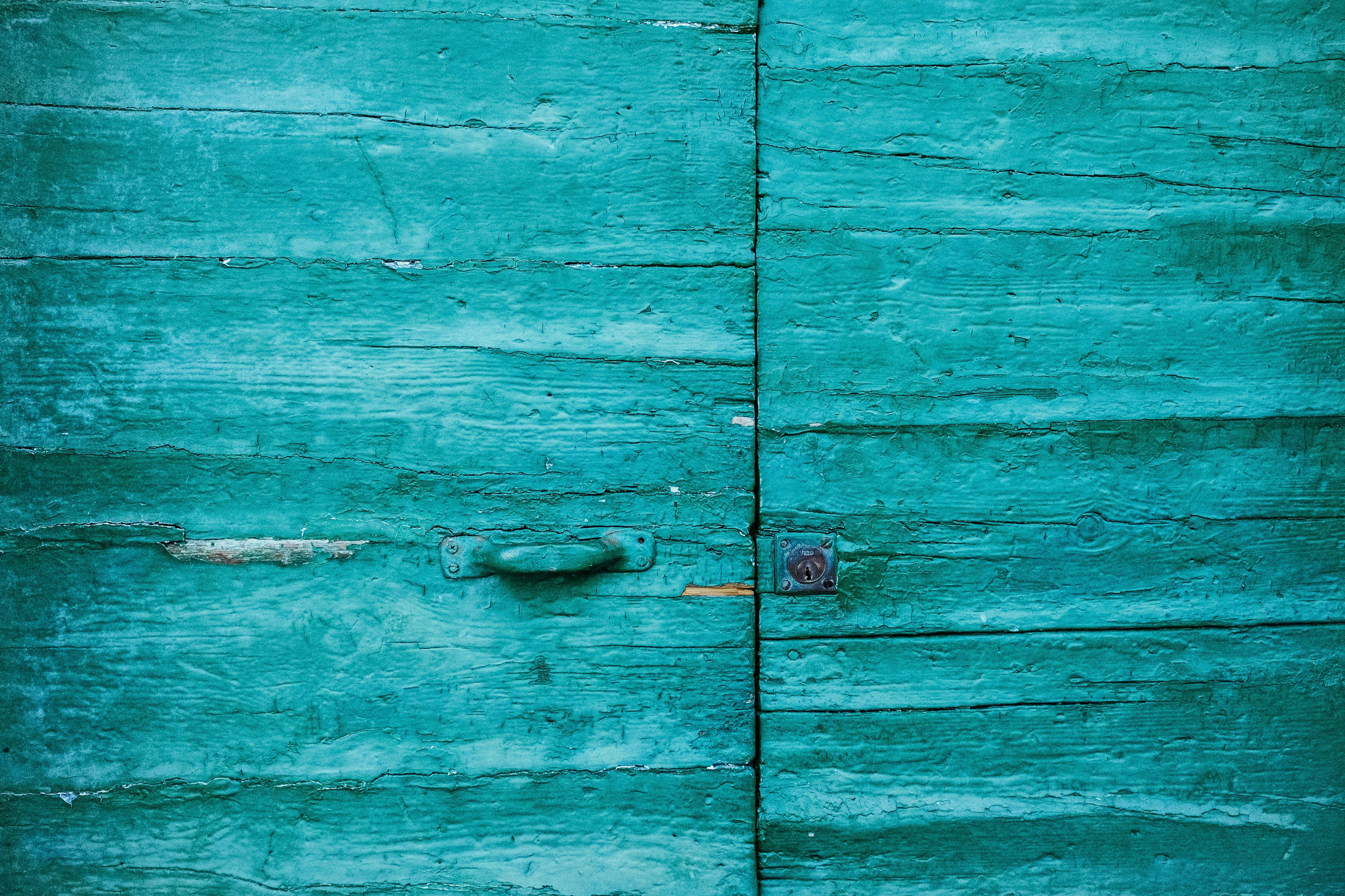closed teal wooden door