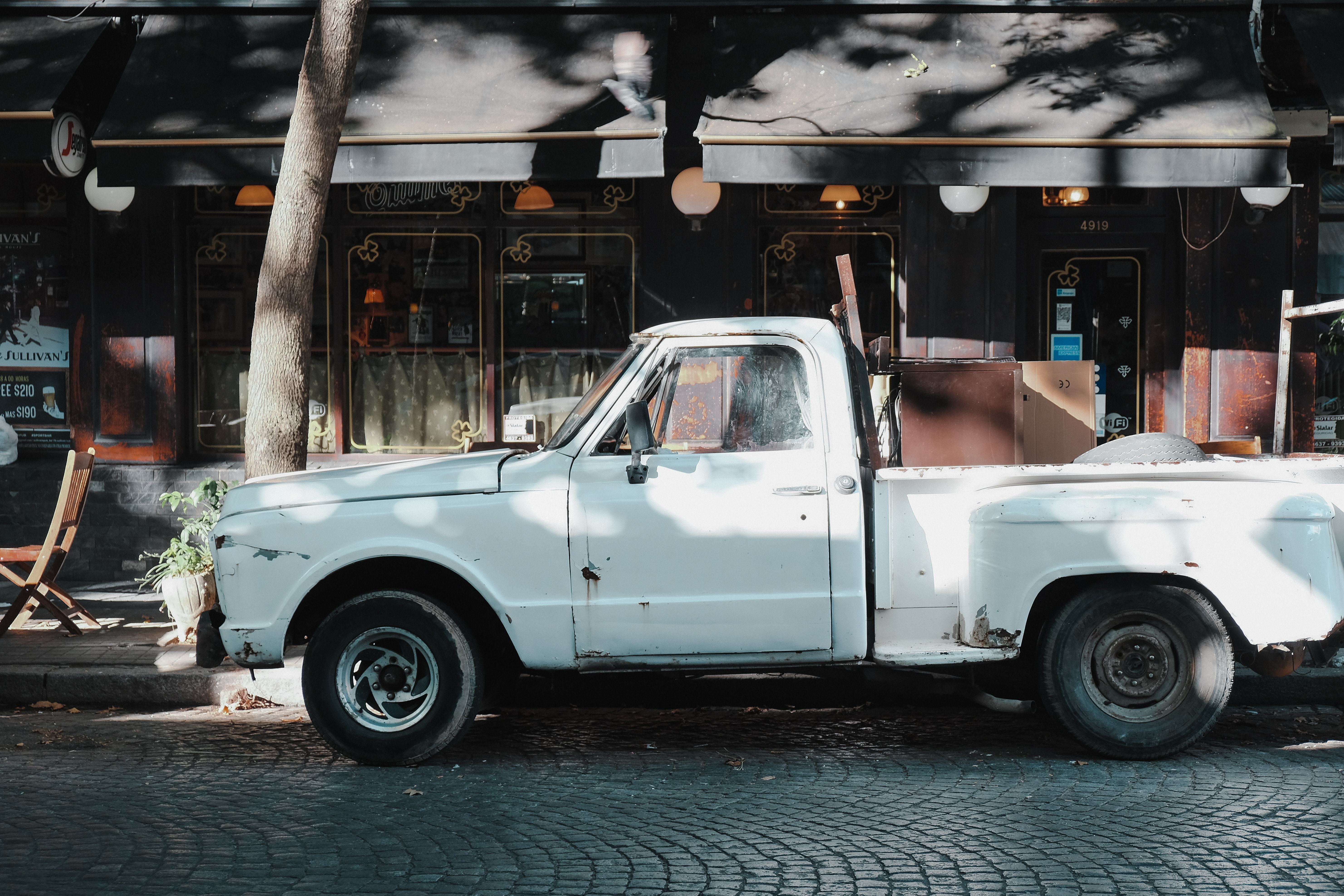 white single cab pickup truck parked beside road