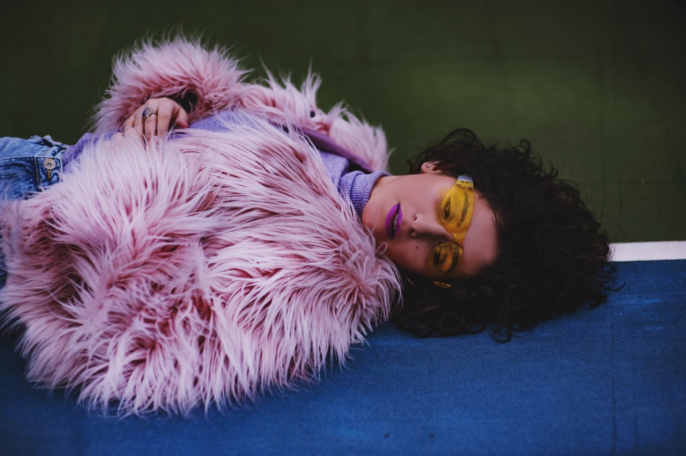 woman wearing pink fur