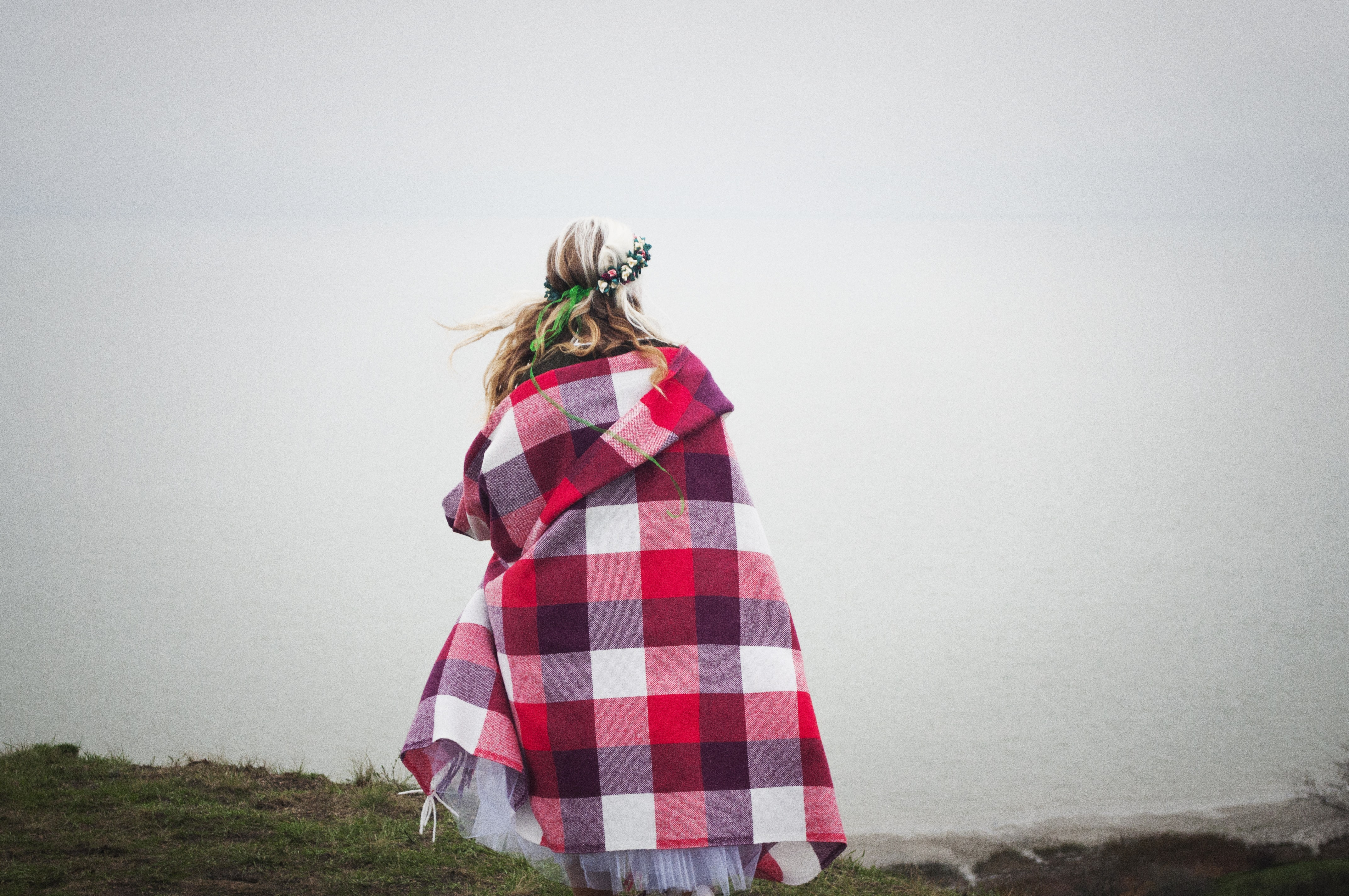 woman covered with blanket