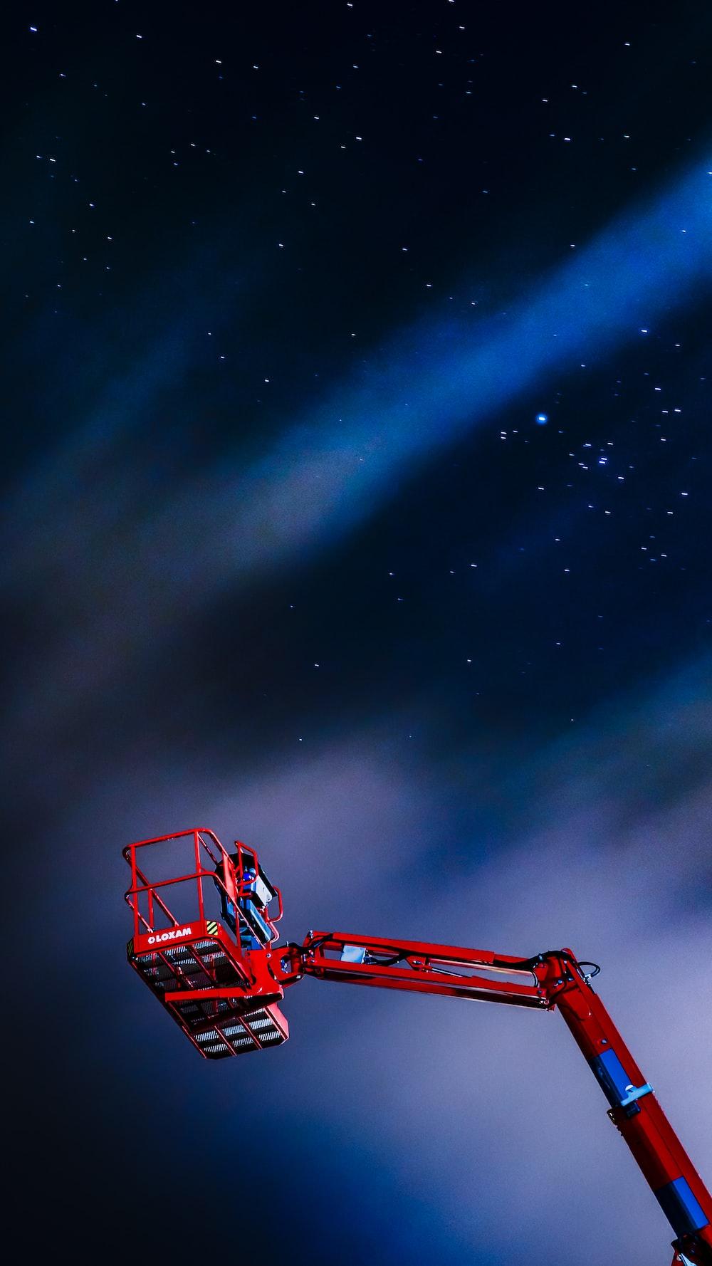 red man lift under starry night