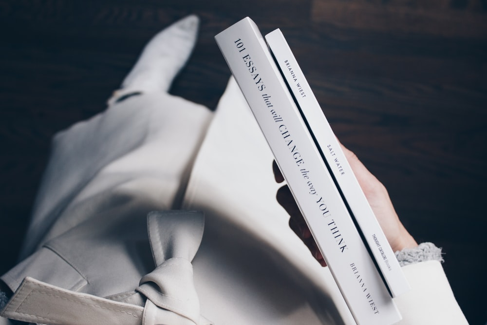 person holding books