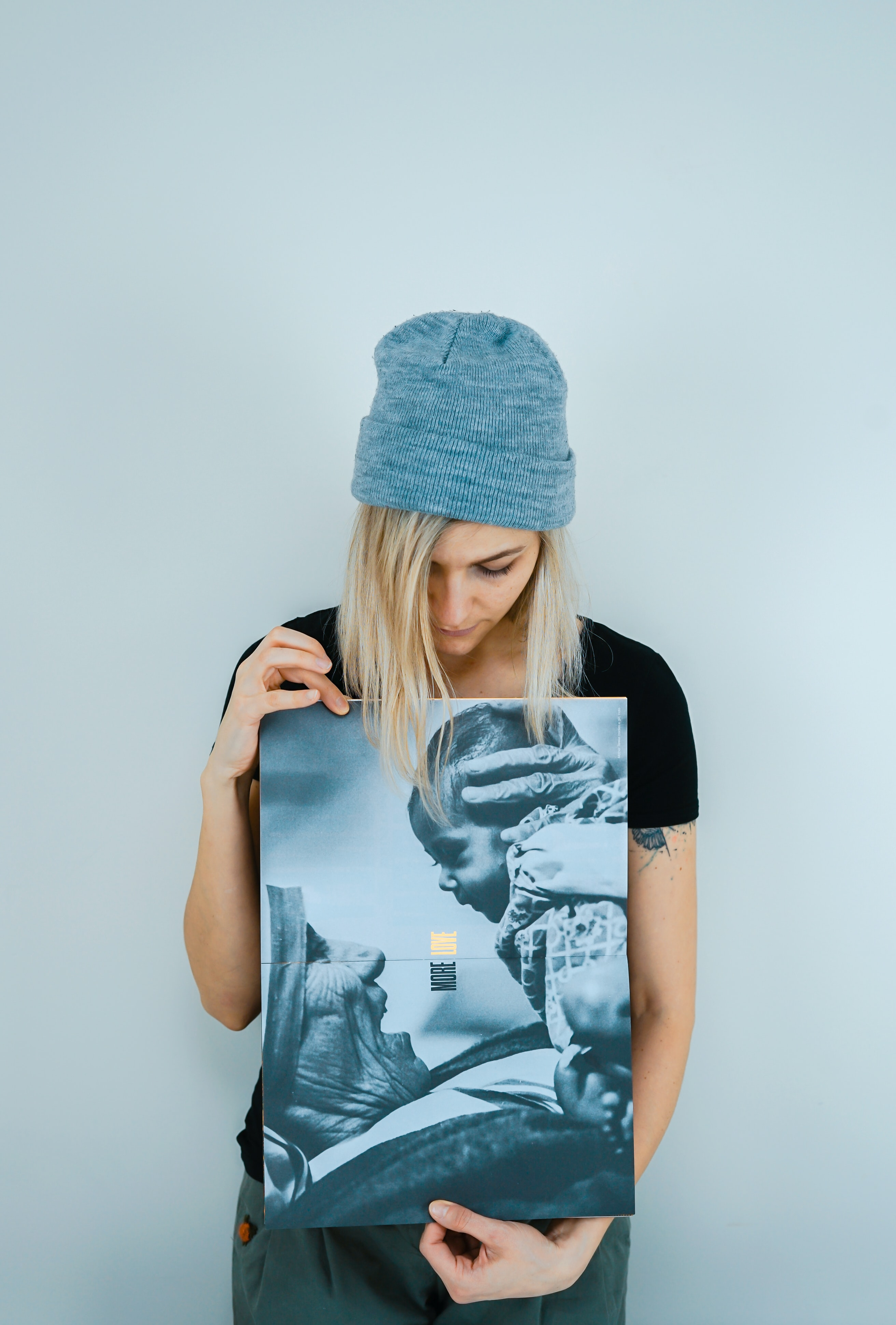 woman holding Mother Teresa holding baby poster
