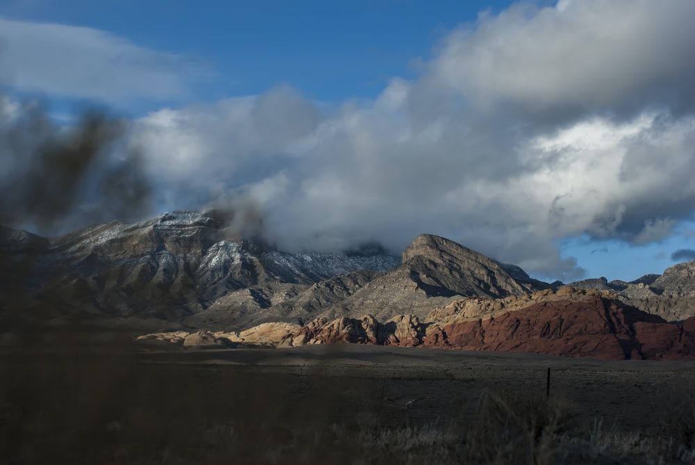 landscape photography of grey mountains under white clouds