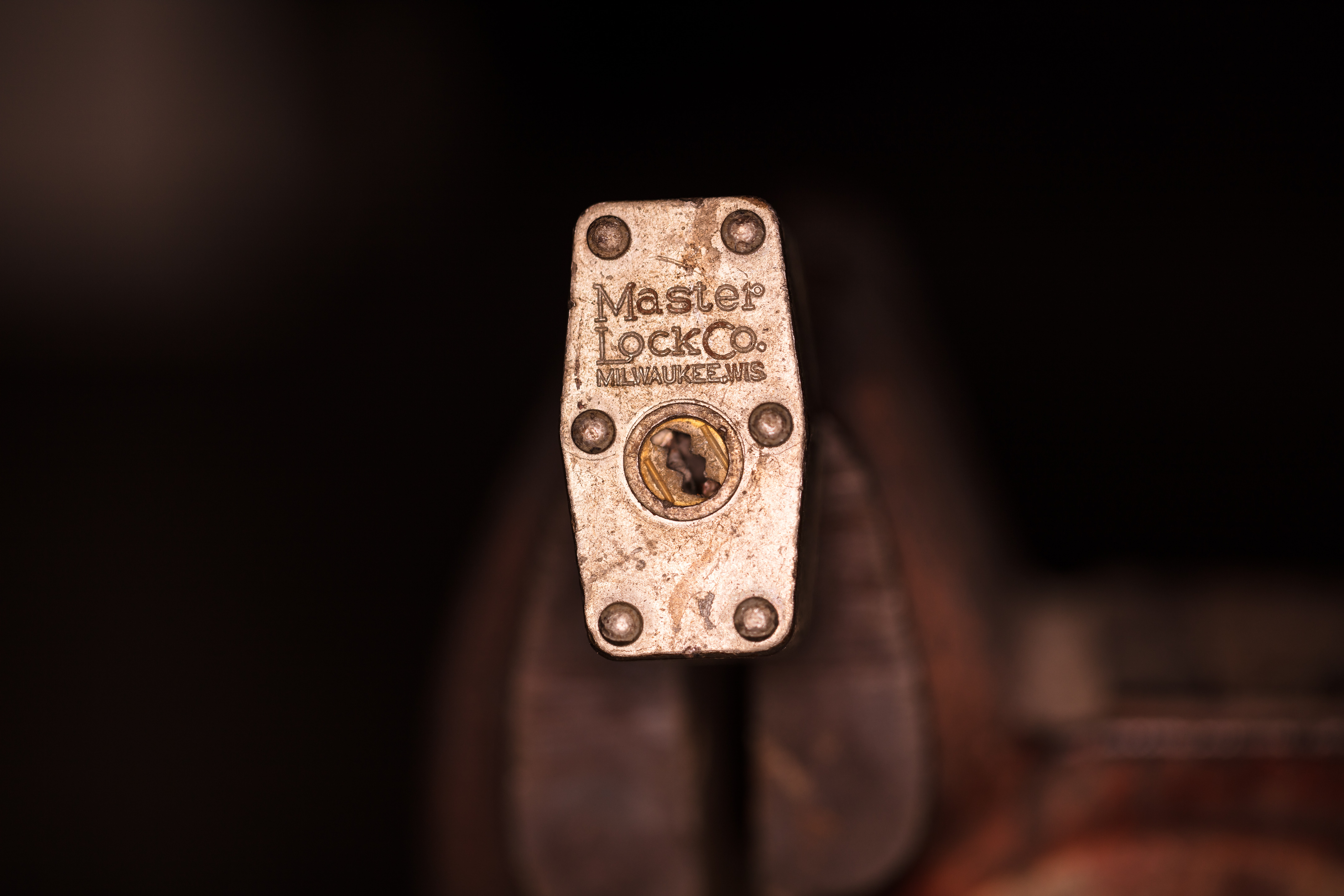 shallow focus photography of stainless steel padlock