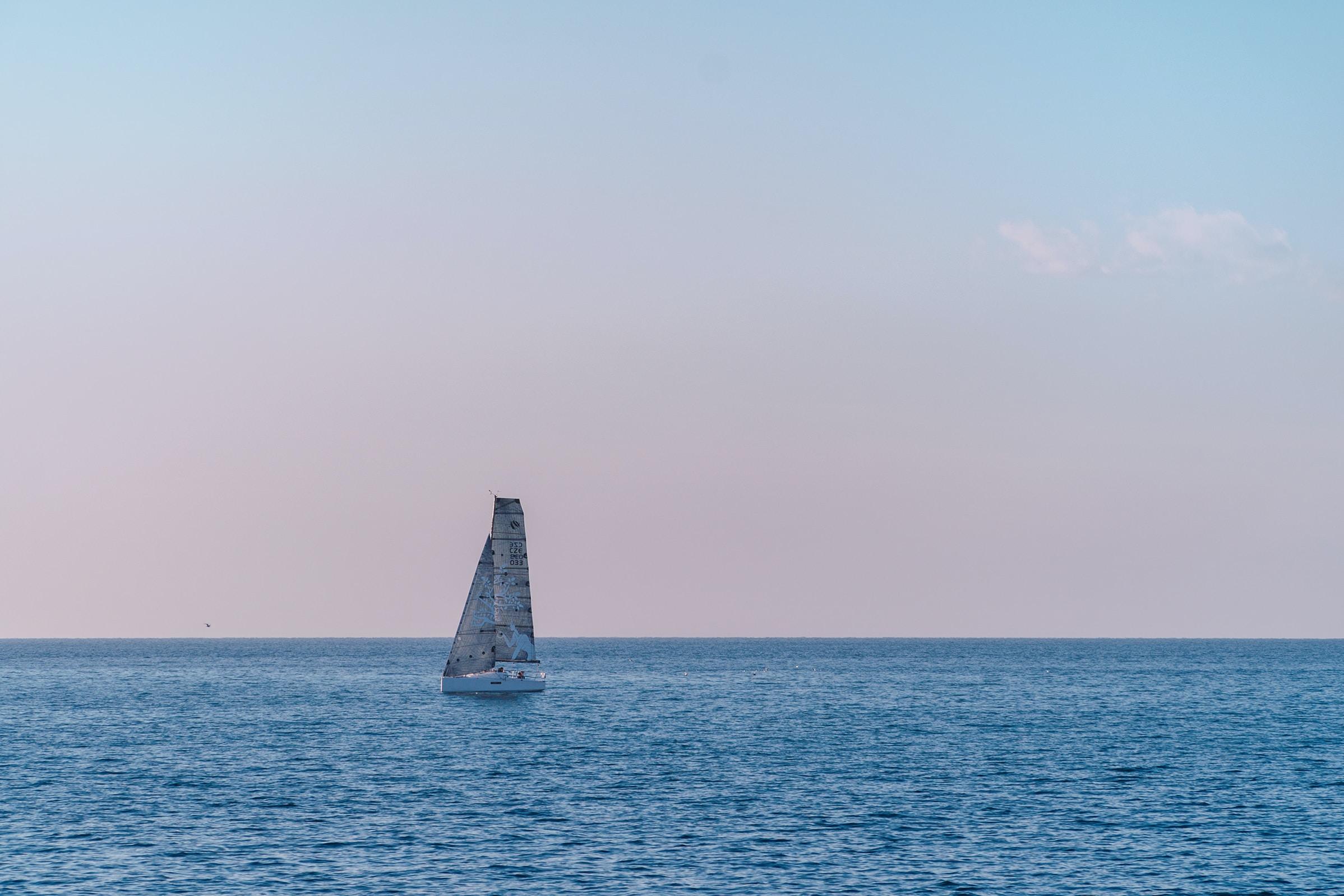 white sailboat on ocean during daytime