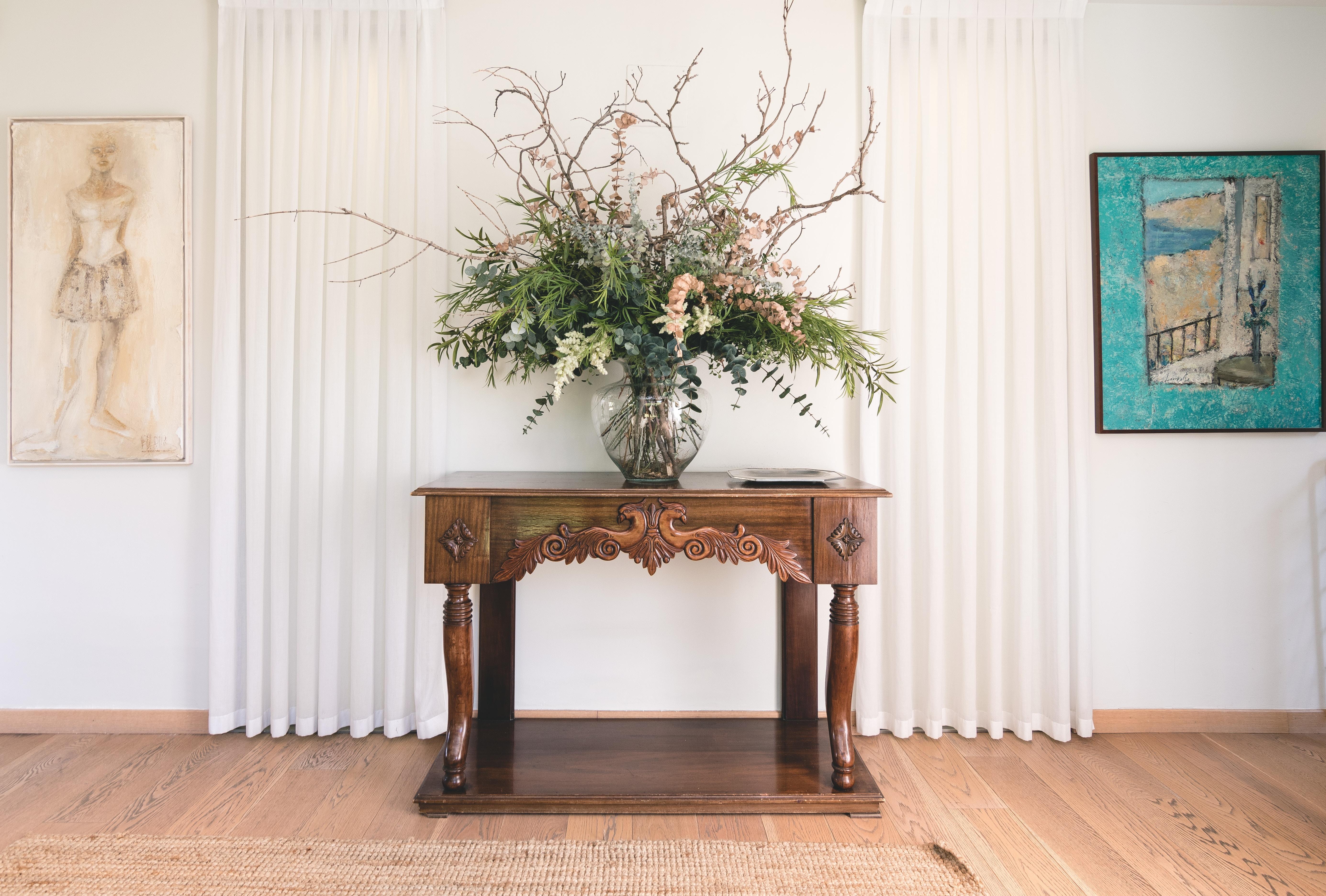 green leafed plant on vase near wall