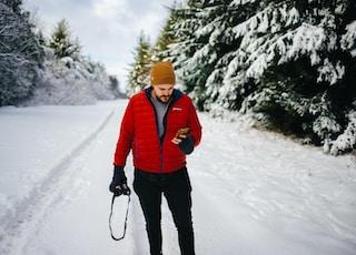 photo of man holding camera