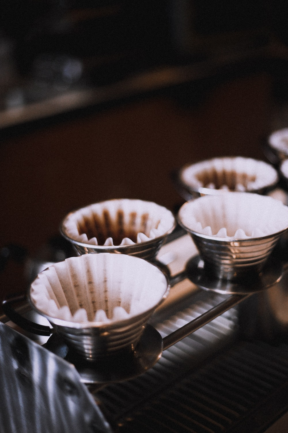 Freshly brewed coffee grounds in paper coffee filters
