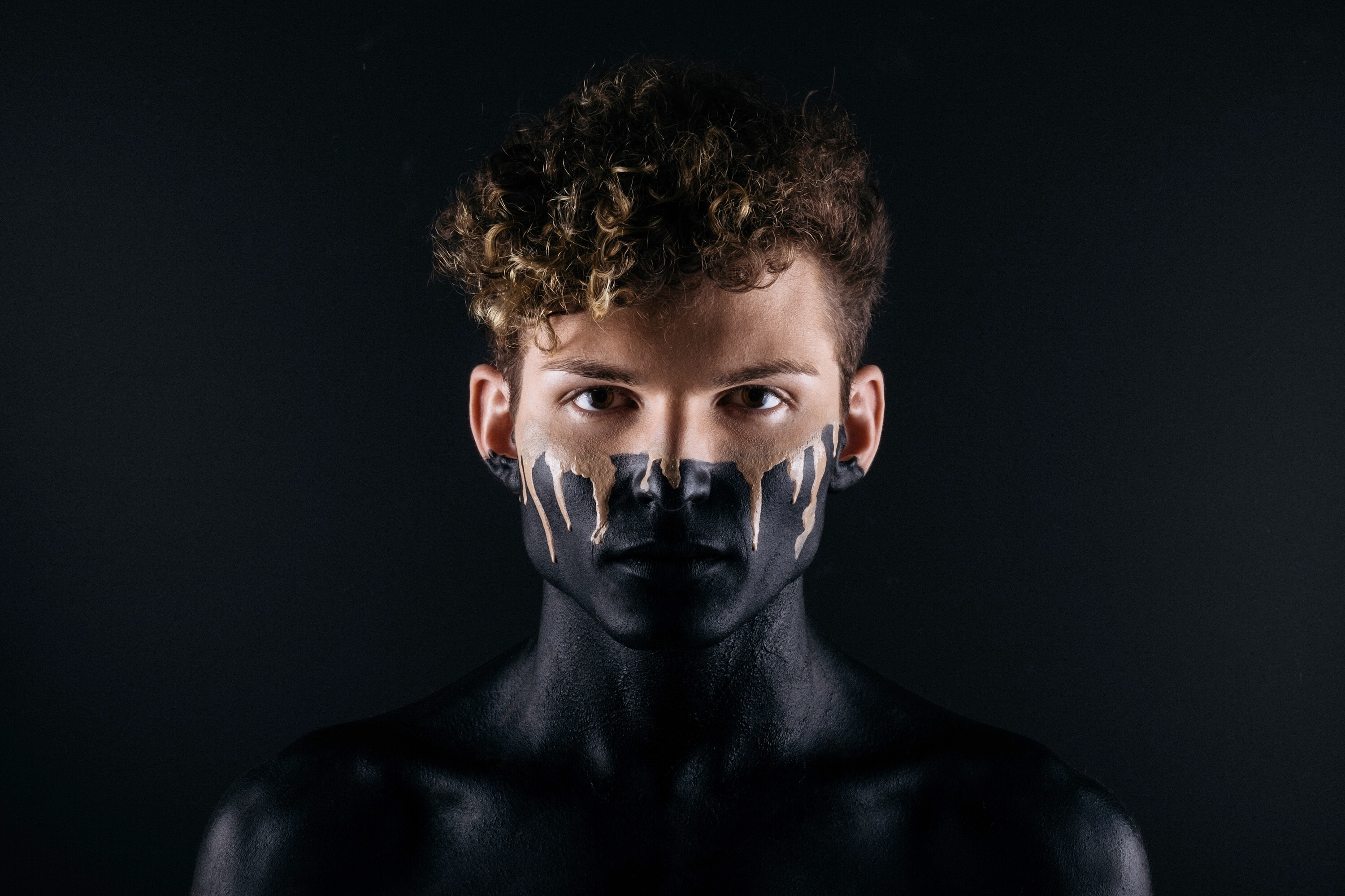 man with black body paint