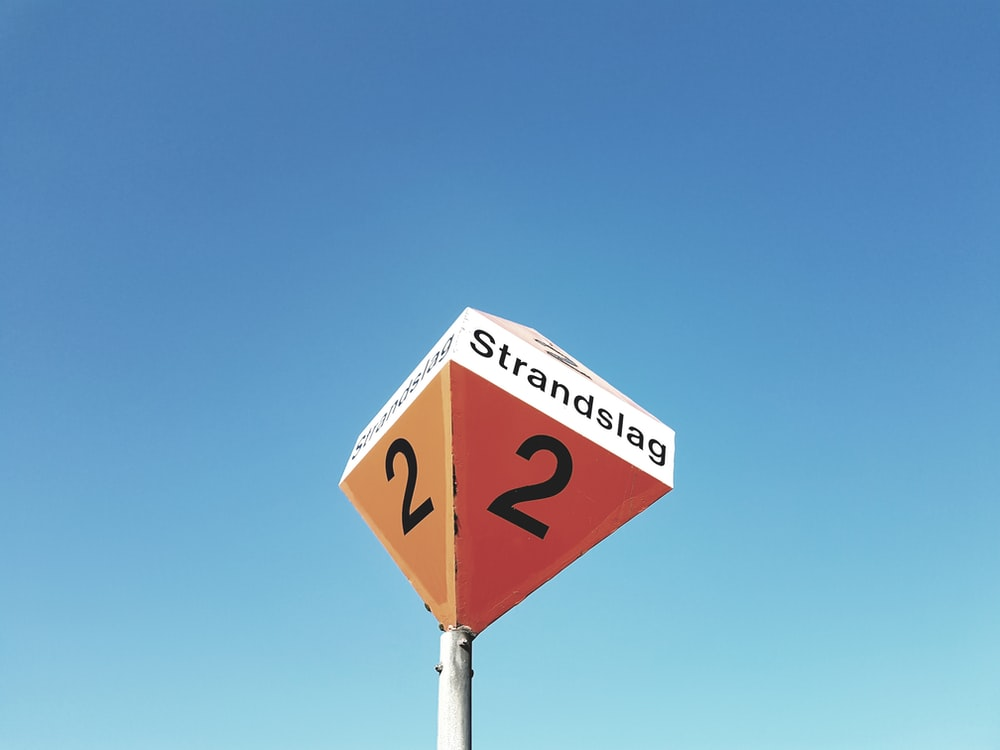 worm's eye view of Strandslag 2 signage