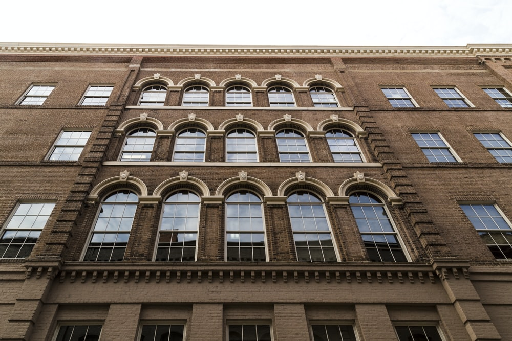 brown 4-storey building