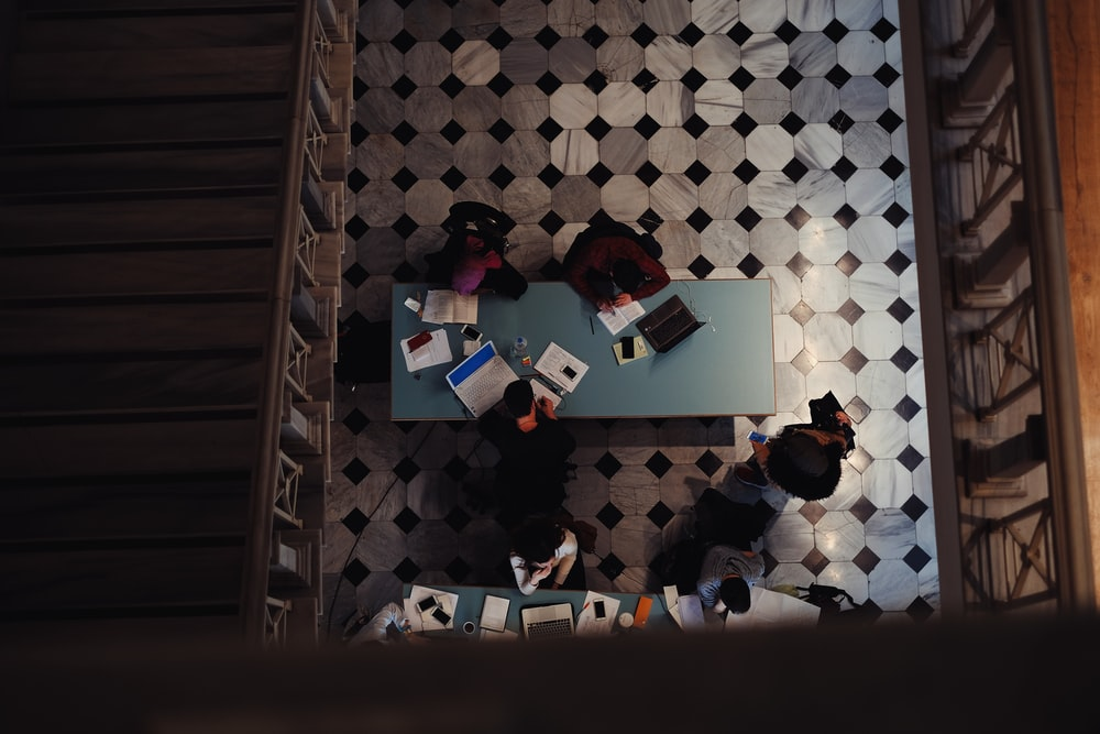 photo of group of people inside library