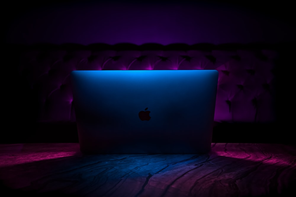 silver iMac on fabric textile