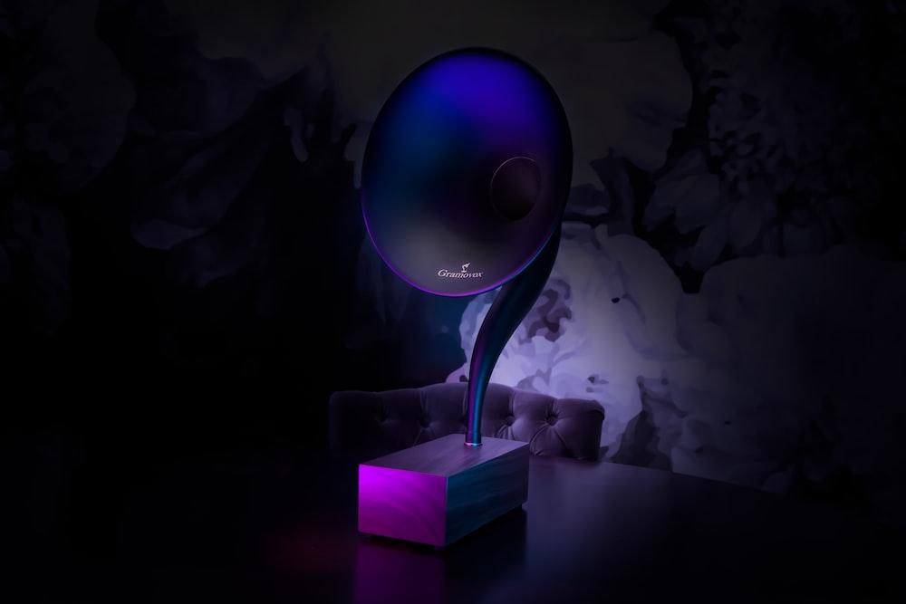 purple table lamp on table