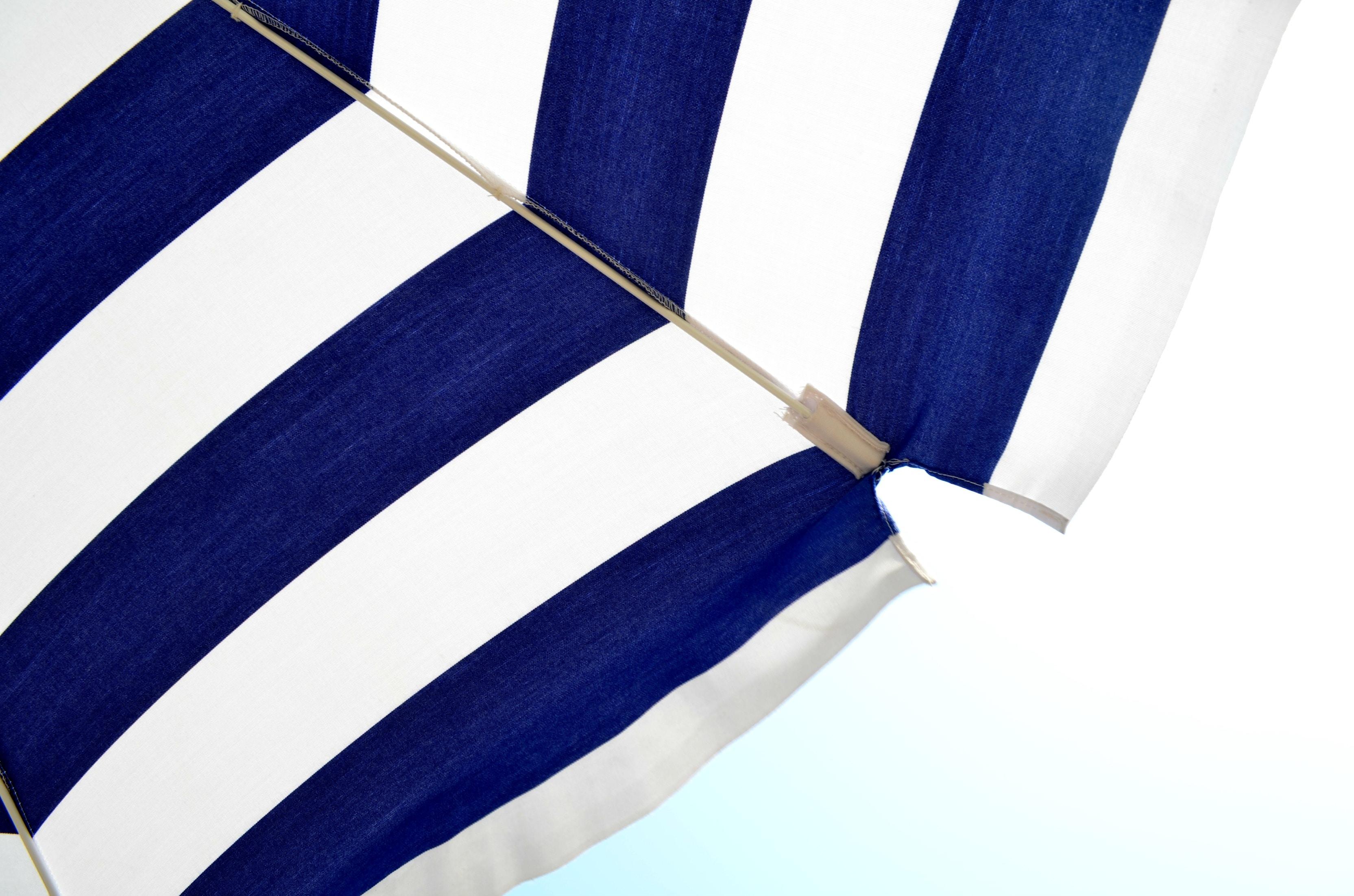 blue and white striped umbrella