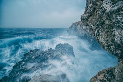 water splashing on rocks cyprus zoom background