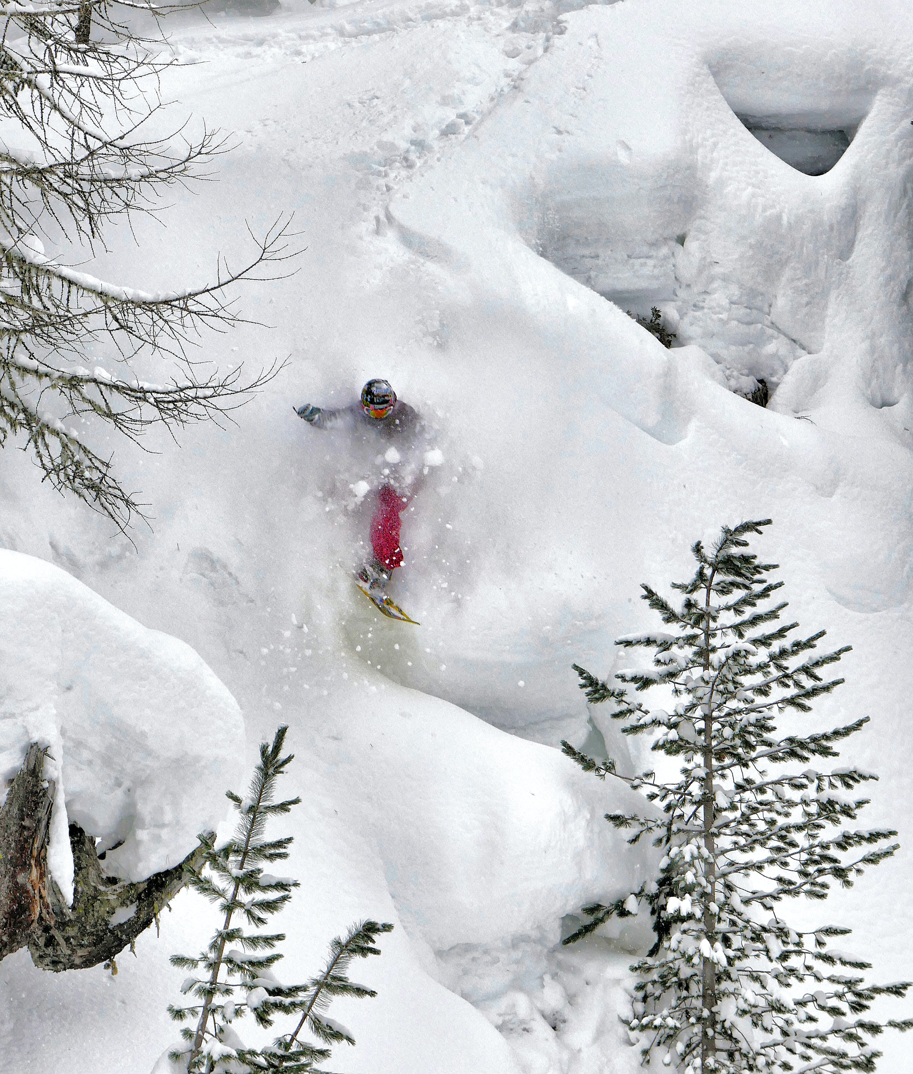 person snow skiing on snow coated mountain