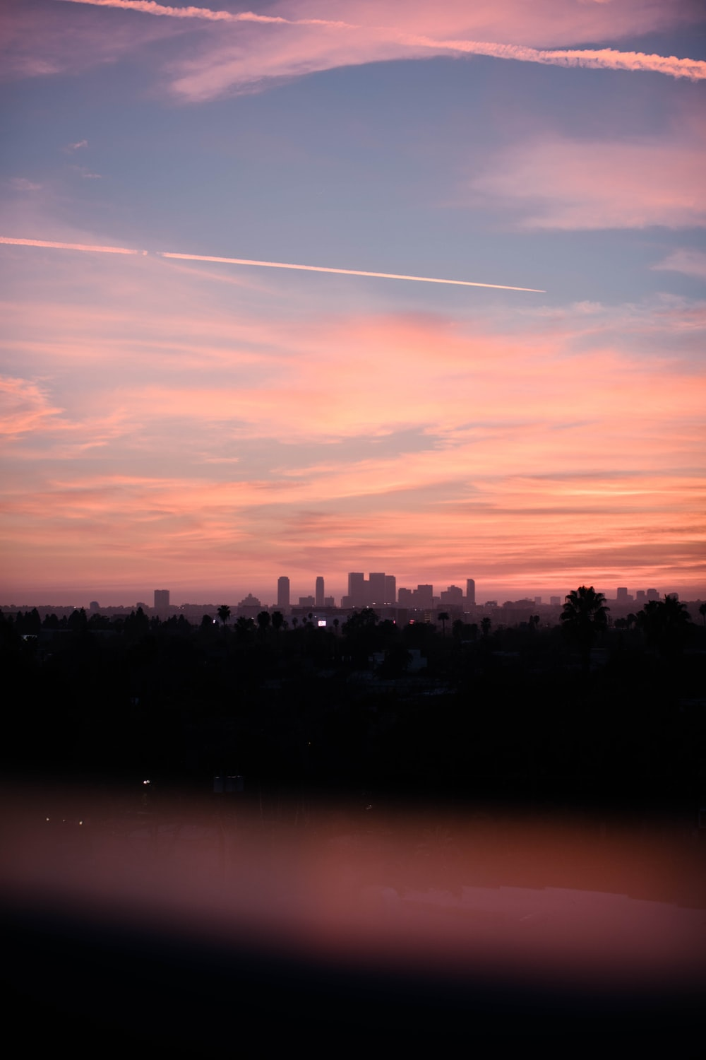 pink sky at sunset over city