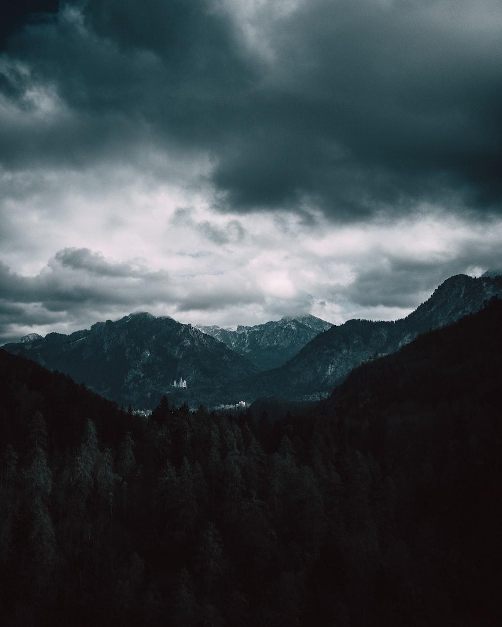 mountains under cumulus clouds