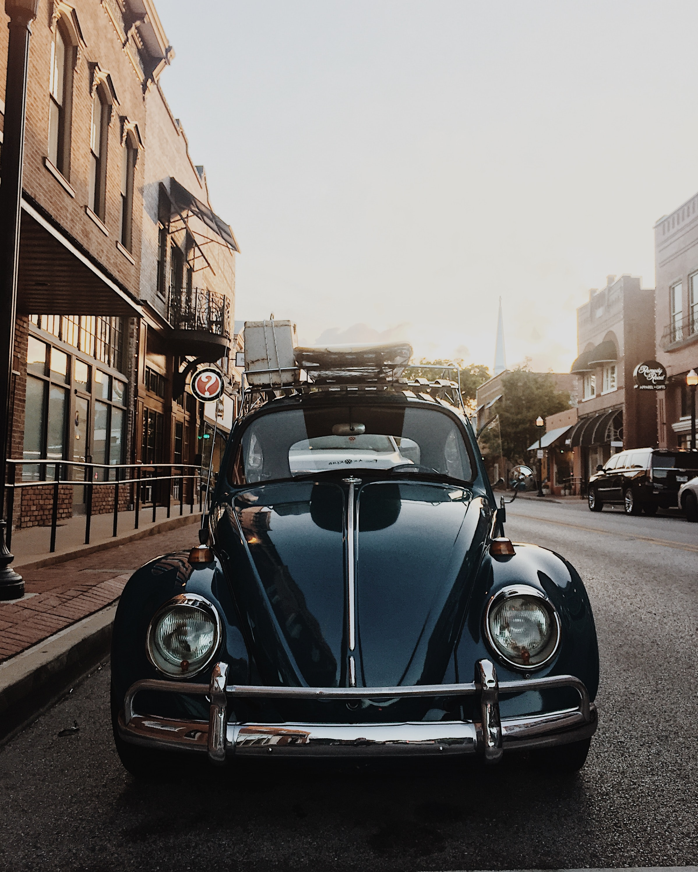closeup photo of black Volkswagen Beetle near building