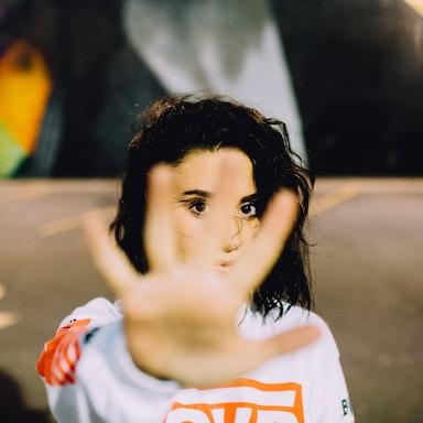 woman wearing white and orange top