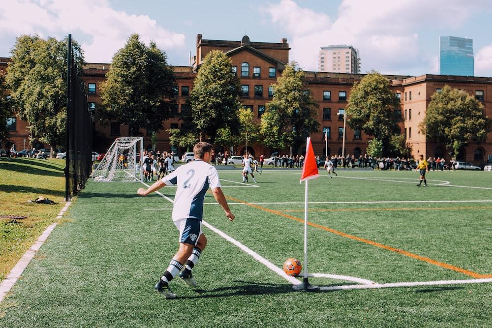 man playing soccer on ballpark