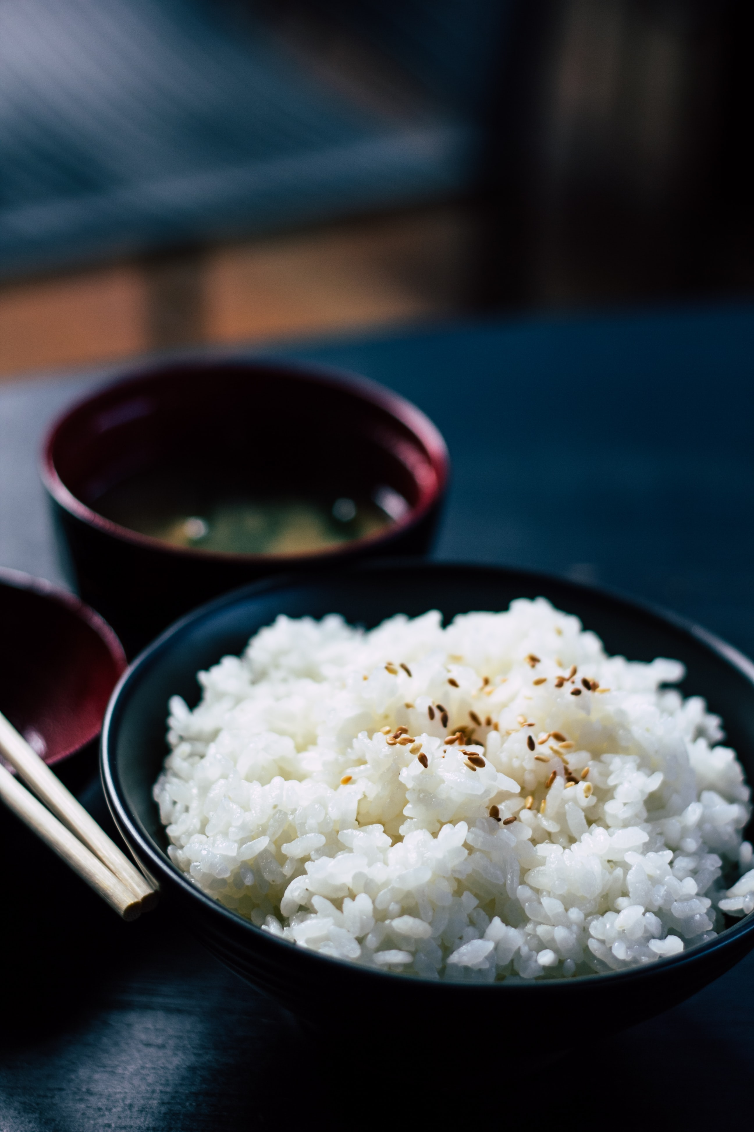 rice with sesame in black bowl
