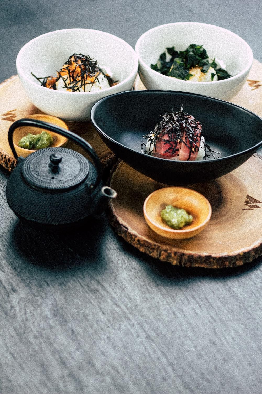 nigiri on black bowl with wasabe