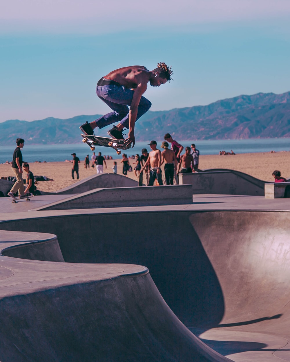 time lapse photo of topless man riding skateboard at the skate park