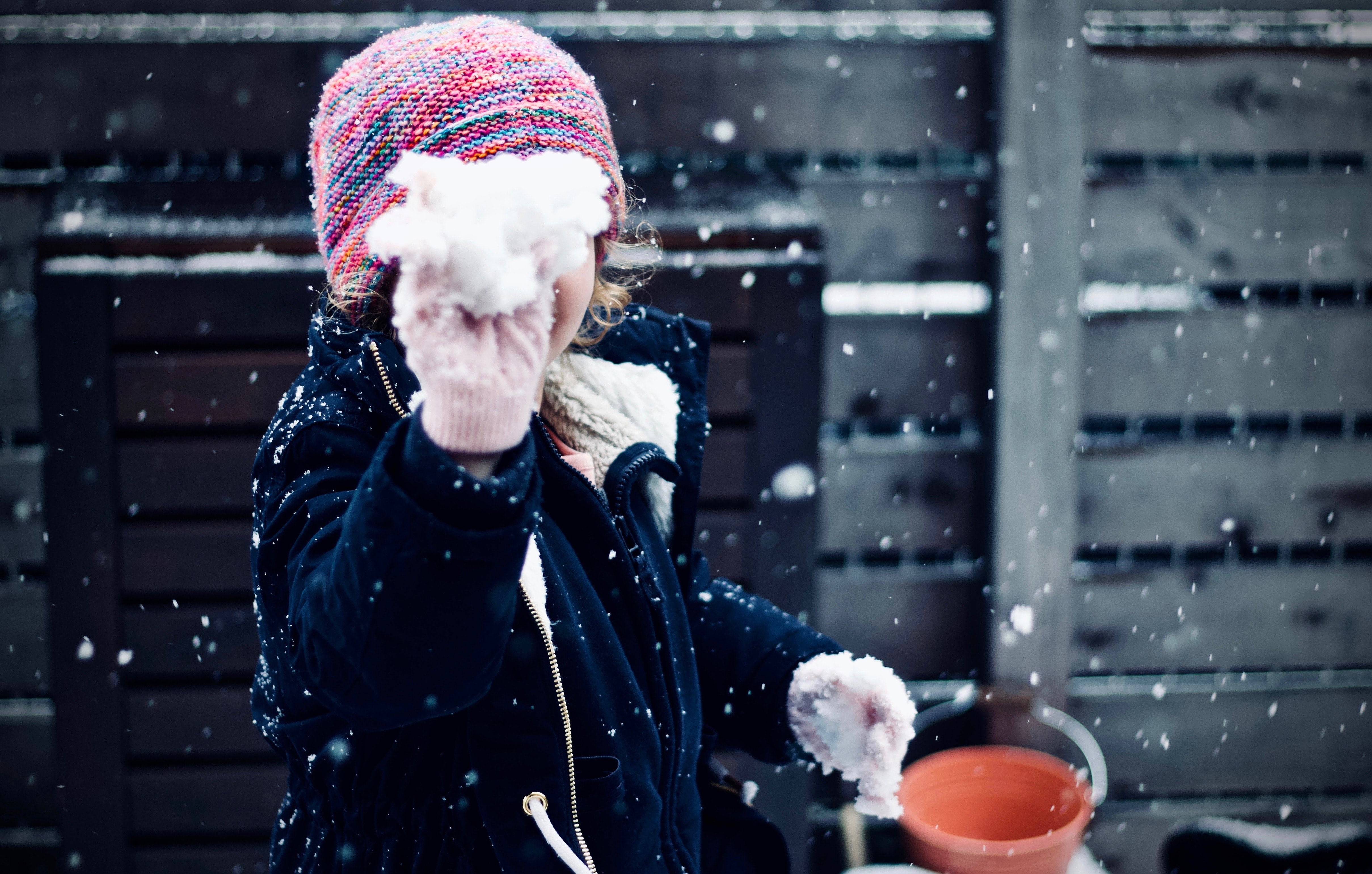 person holding snow