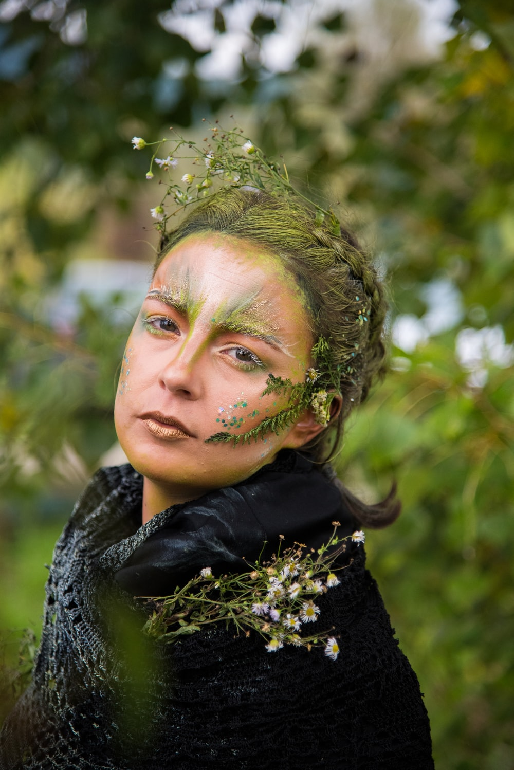 selective focus photo of woman with nature-themed makeup