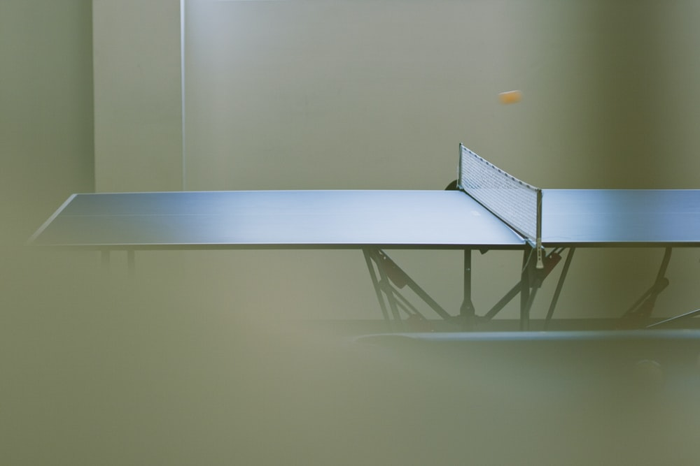 black ping pong table photography