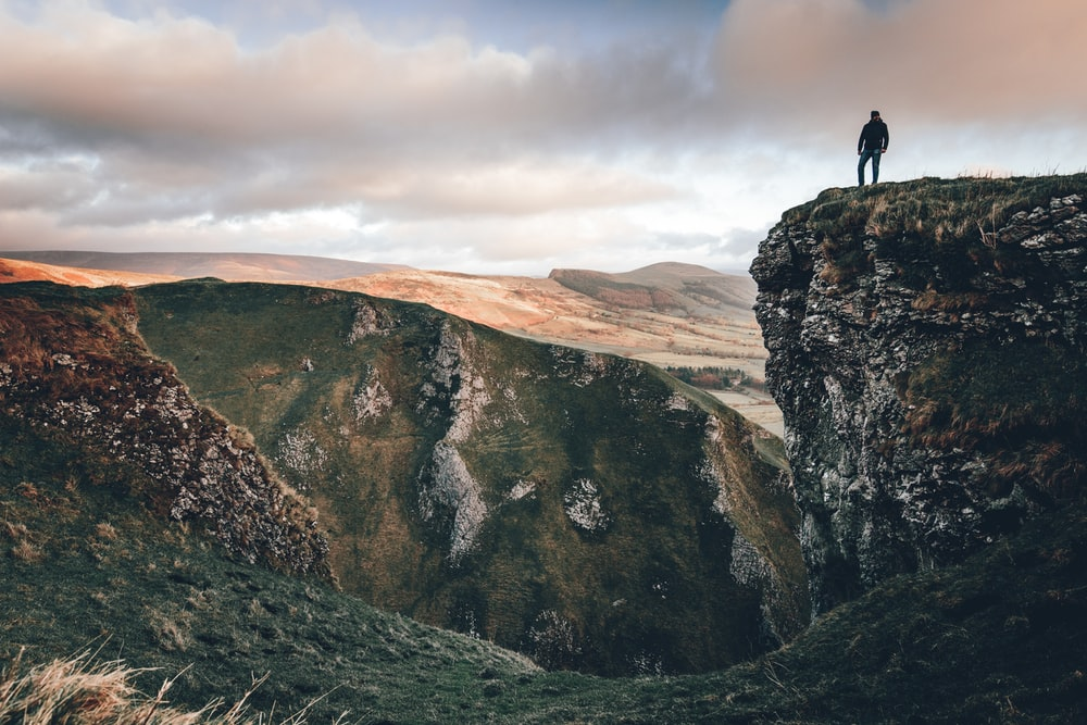 person standing near the cliff