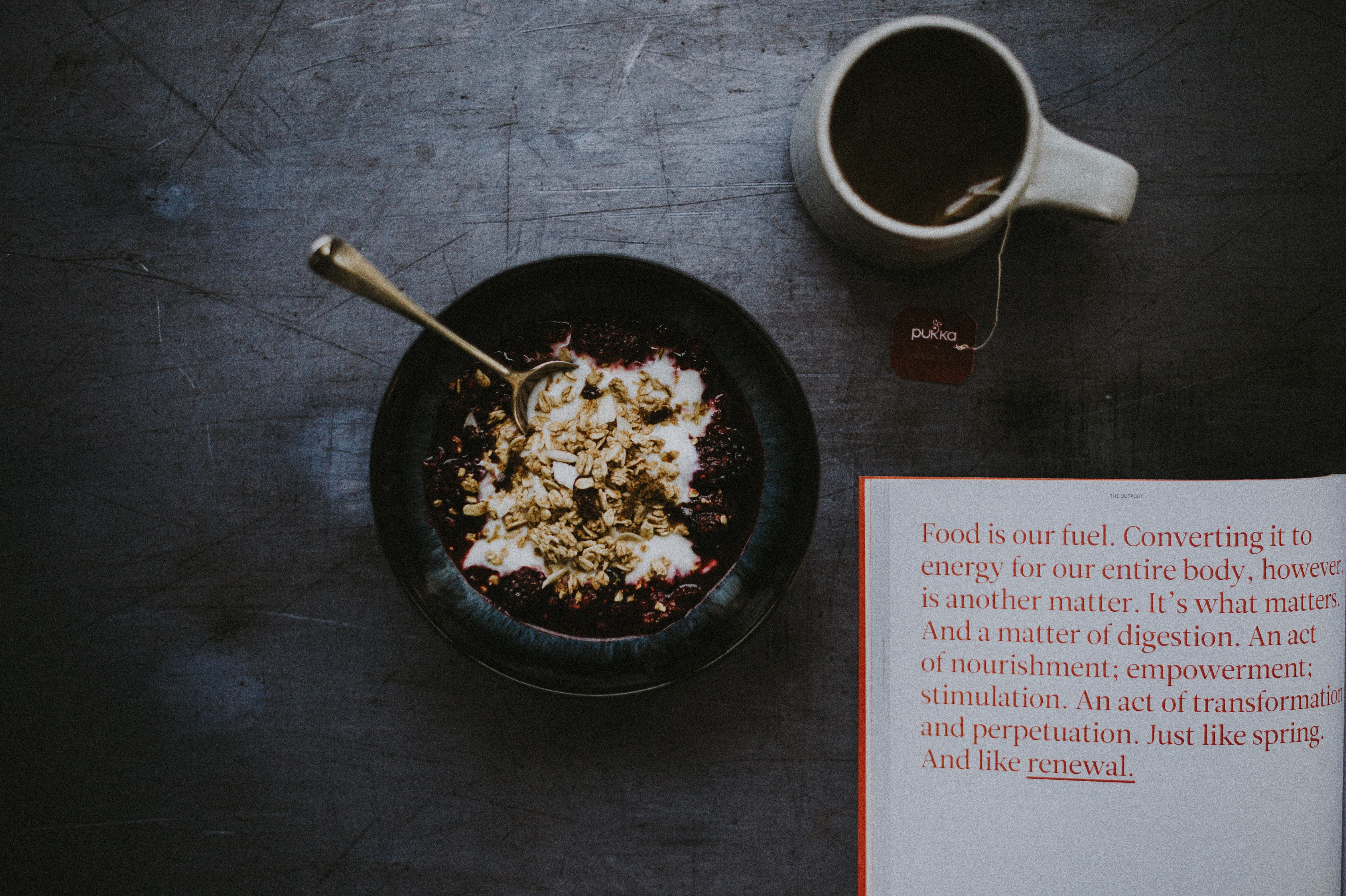 cereal in black bowl beside coffee cup