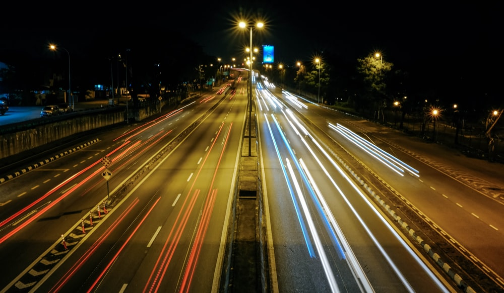 time lapse photo of cars on road