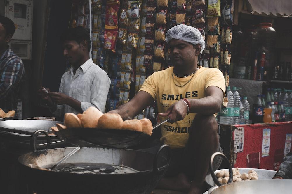 man holding cooking pat