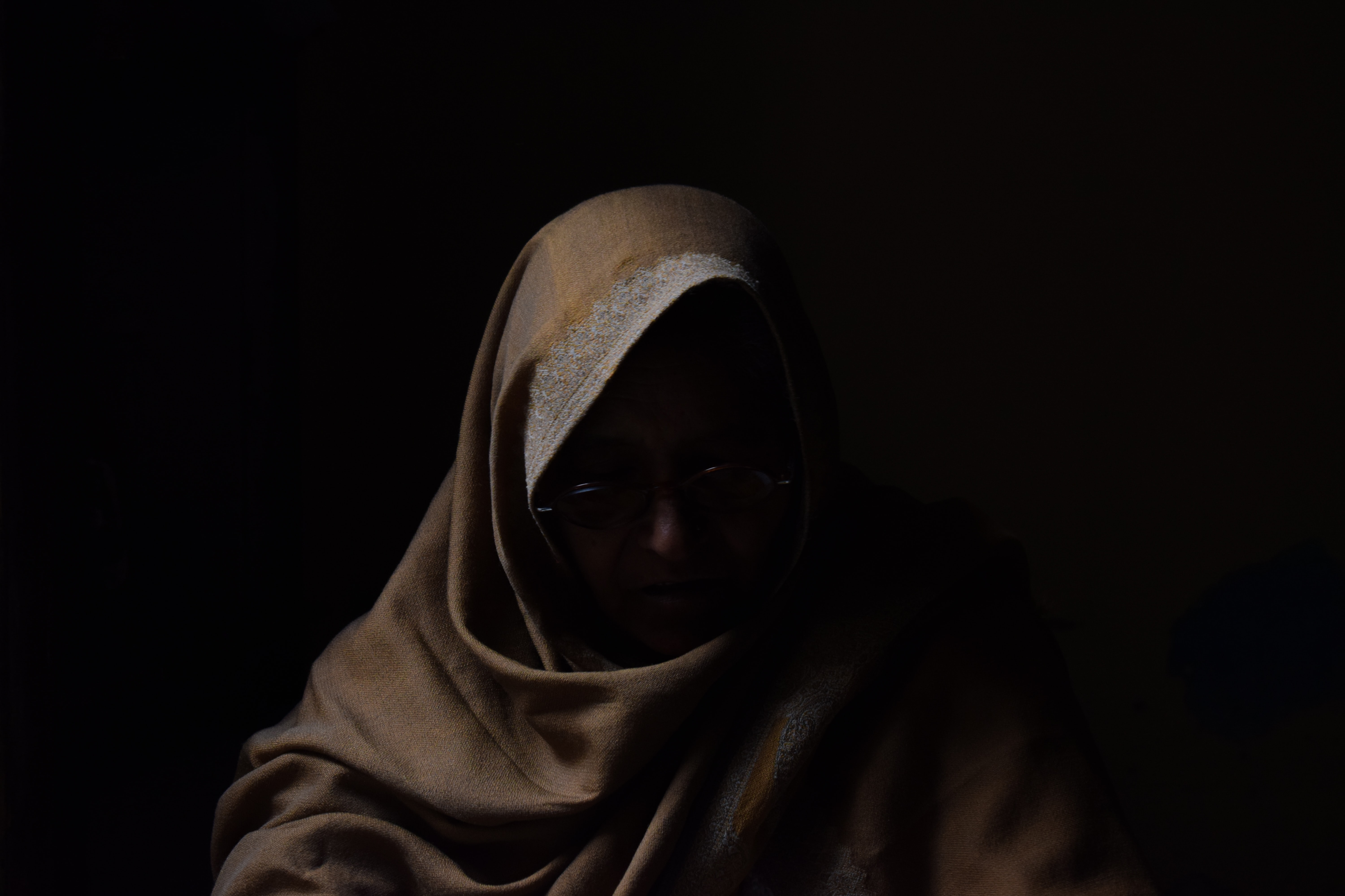 person wearing eyeglasses and robe