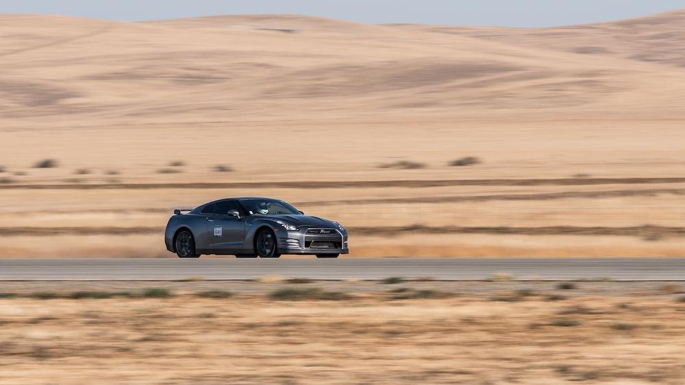 Nissan GTR passing through road on desert