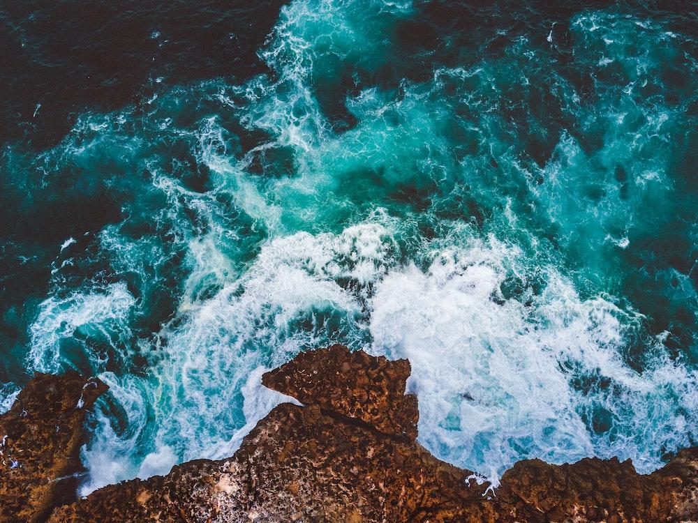 seawave splashing on rock