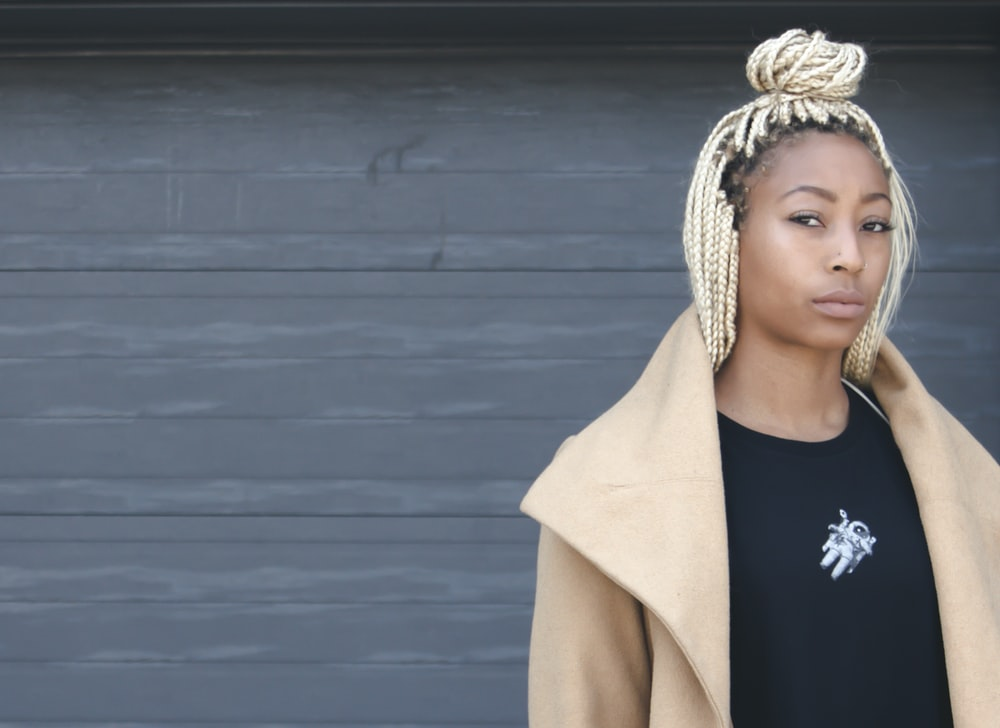 woman standing near gray wall