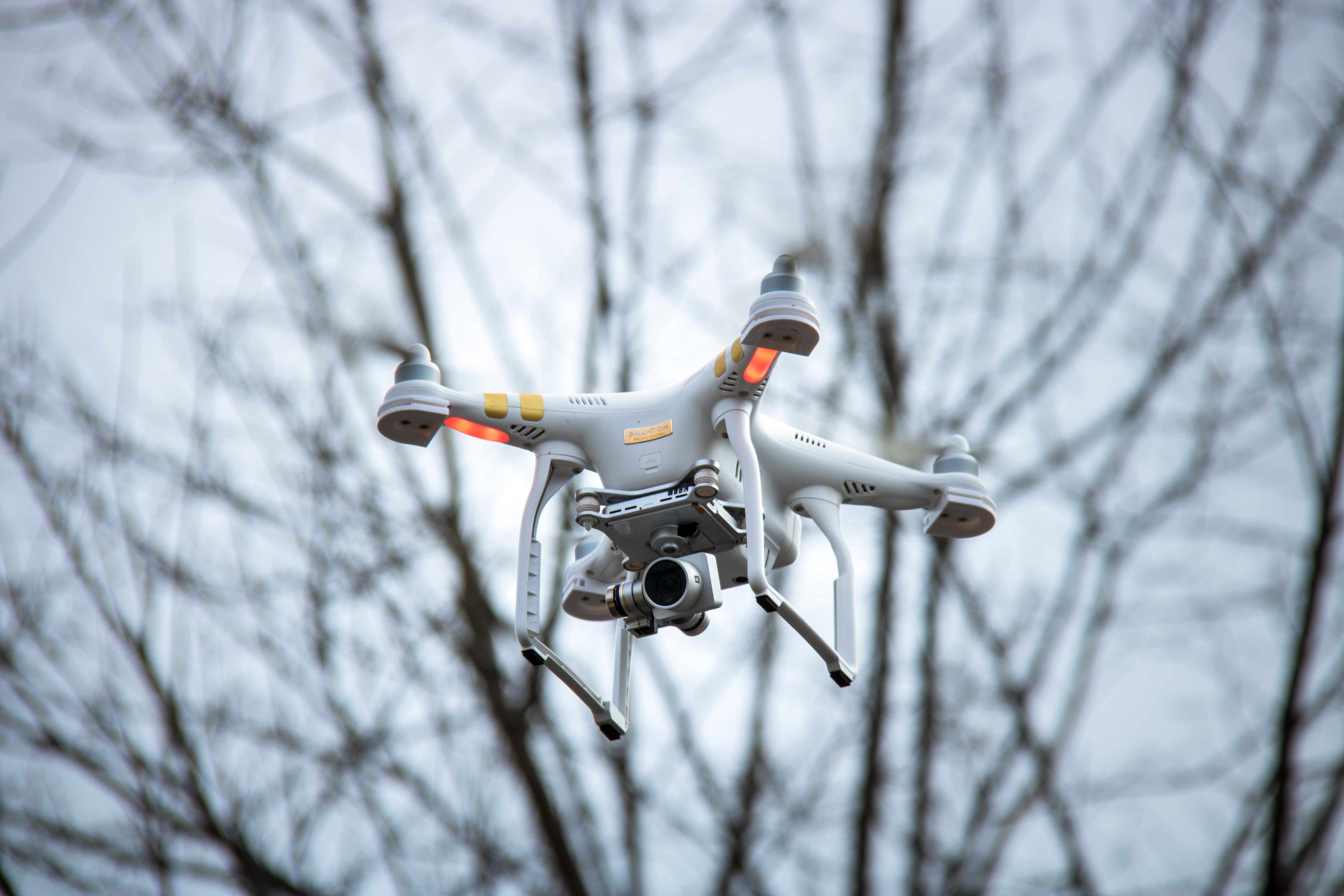 shallow focus photography of quadcopter drone