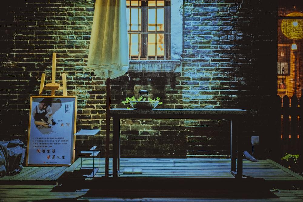 green plant on table near window