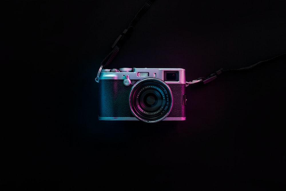 black and silver SLR camera