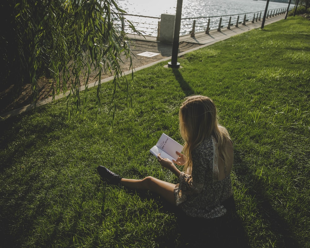 A girl reading in summer
