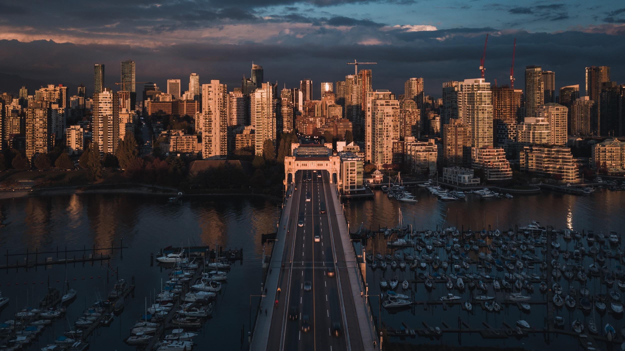 grey concrete bridge toward city