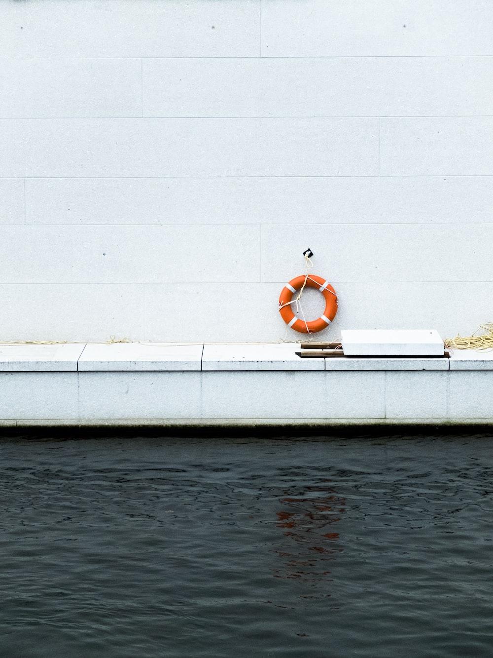 hanged orange life ring near pool