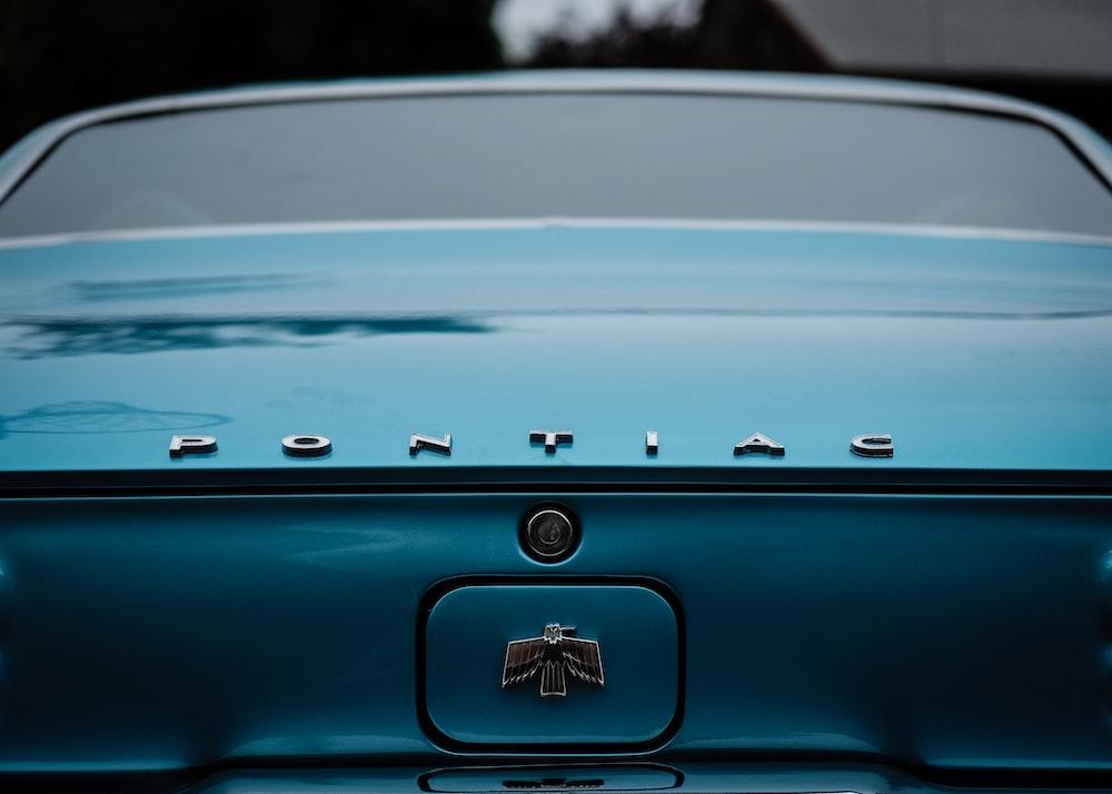 teal Pontiac car