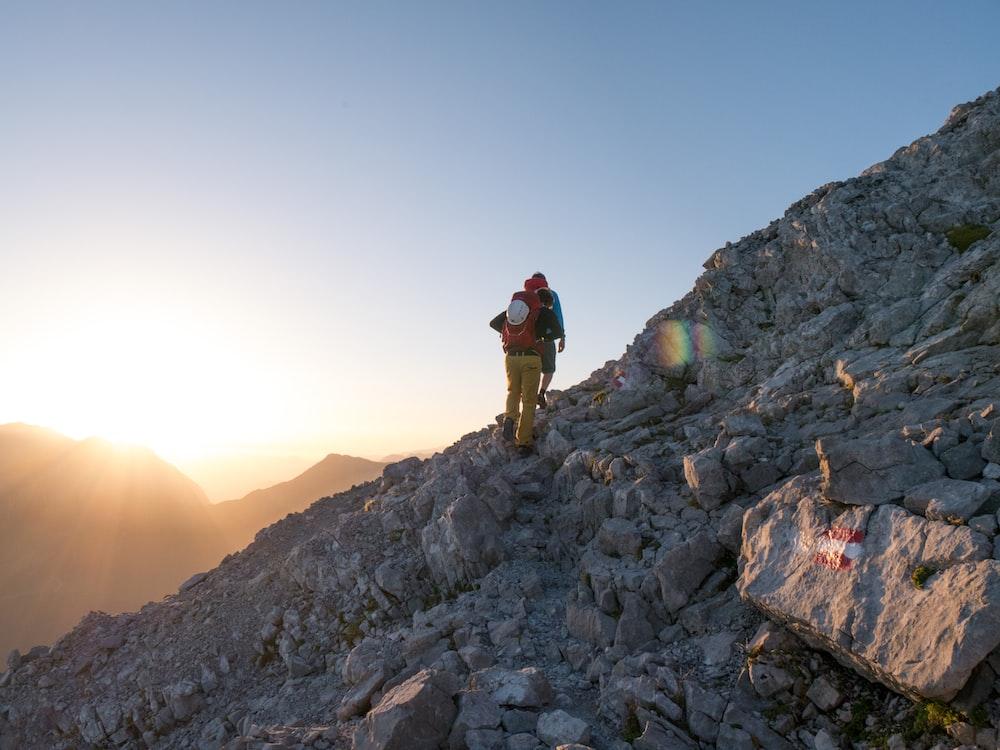 person climbing on mountain